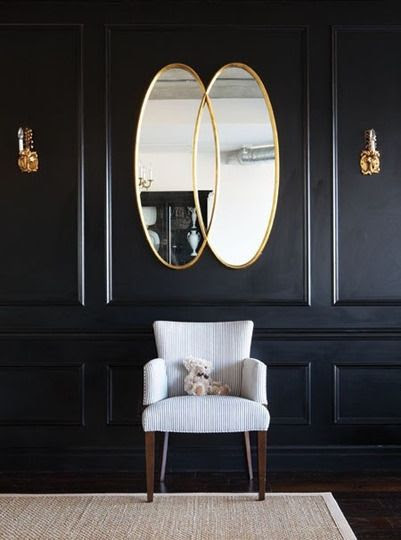 THe gold and black is cool. Really like that mirror. (especially for an entryway)
