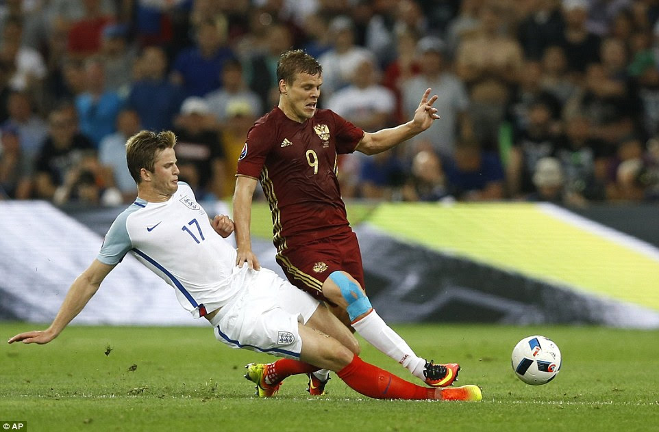 Tottenham midfielder Dier (left) puts in a crunching, well-timed tackle on Aleksandr Kokorin during a goalless first half in Marseille