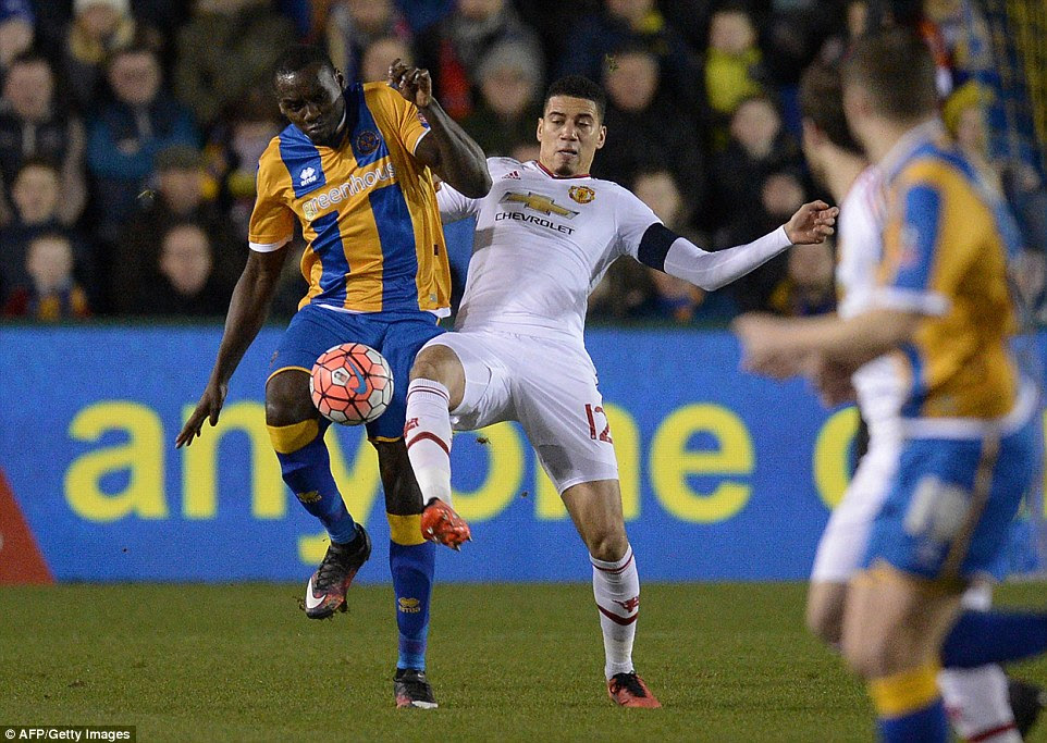 England international Smalling battles withJermaine Grandison as the League One side provided a physical test