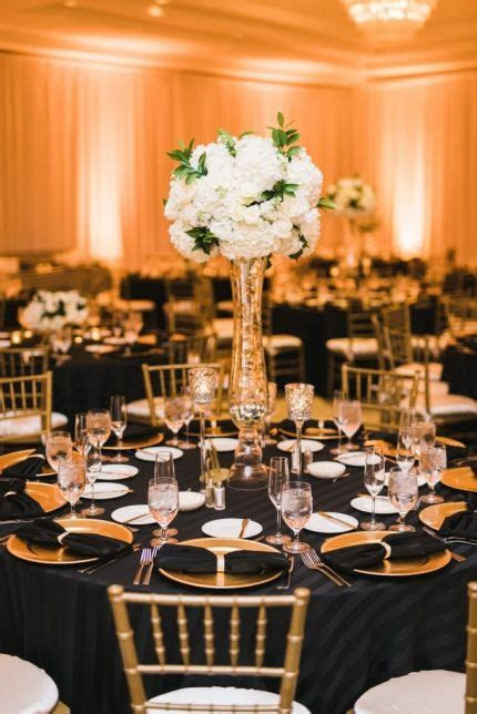 Black, gold, and white wedding reception decor. Hydrangea