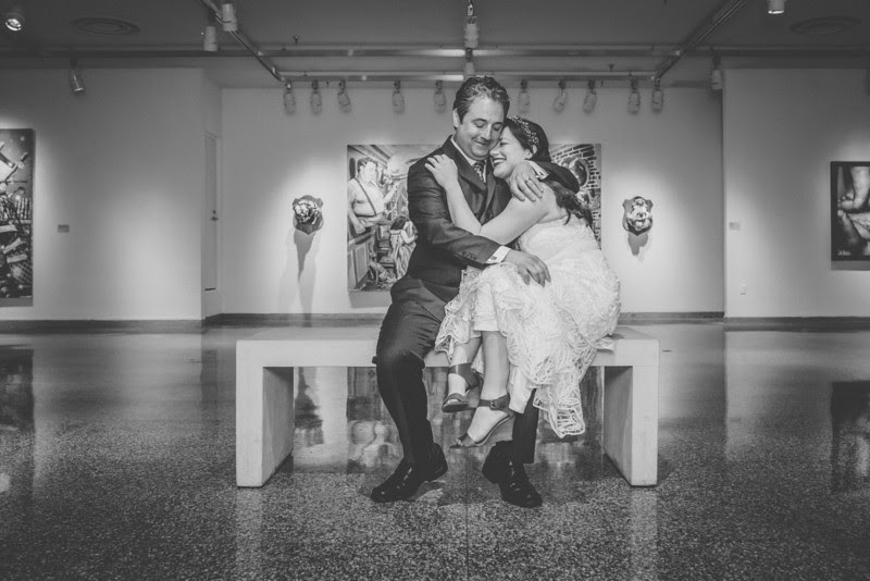 Bride and Groom Photos in the Funderburg Gallery at Rockford Art Museum Gallery in Rockford IL following a garden wedding ceremony in Rockford, IL.