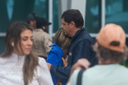 Anguished families of victims gather in grief and wait for news.
