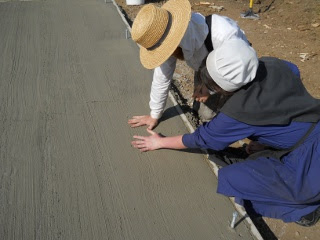 Spring Ranchfest 2012 Betrothed Couple Making Handprints in Concrete of Their Eventual Cabin