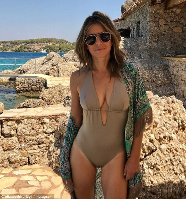 Smouldering:Elizabeth Hurley yet again used her age-defying assets to her advantage as she stripped down to the latest in her string of sexy swimwear on Saturday, in a snap which would undoubtedly delight her 685,000 Instagram followers
