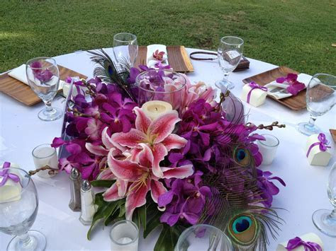 Centerpiece with hurrican candle and peacock feather