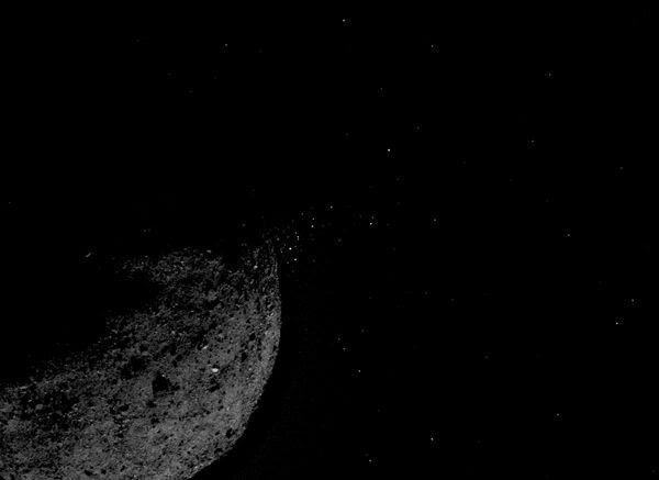 An image that NASA's OSIRIS-REx spacecraft took of a cloud of rock fragments that floated away from asteroid Bennu into deep space...on January 19, 2019.