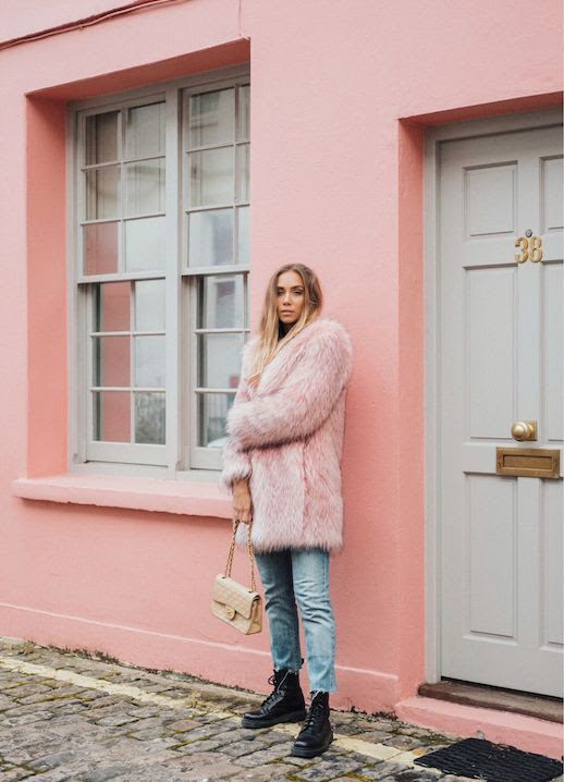 Le Fashion Blog Pink Faux Fur Coat Raw Hem Jeans Black Combat Boots Via Lisa Place