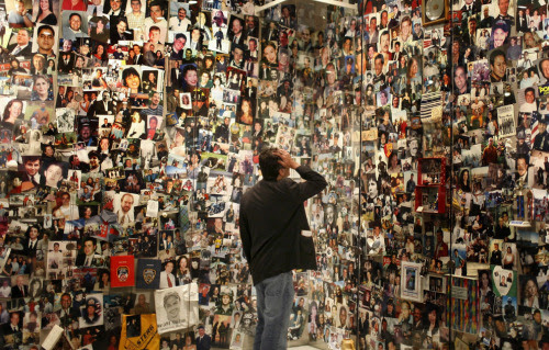 David Filipov looks for a picture of his father, Al Filipov, at the Tribute WTC Visitor Center in New York City. The center is run by the September 11th Families Association as a museum and memorial to the victims and history of the World Trade Center and the 9/11/2001 attacks. Filipov's father was on American Airlines Flight 11, the first plane flown into the towers. (Scott Lewis) (via Remembering September 11th - The Big Picture - Boston.com)