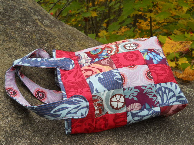 quilted bag on rock