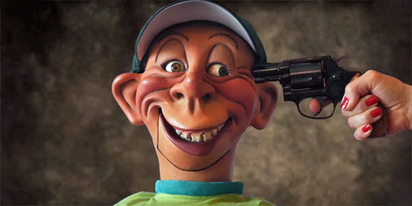 Jeff Dunham's puppet, Bubba J., gets a gun to his head as he attempts to reveal he's voting for Trump (Photo: Screenshot/YouTube)