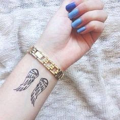 Small Angel Wings Tattoos On Left Wrist