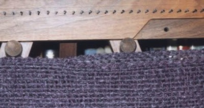 Closeup showing how the 2 triangles are finished on the tri-loom.