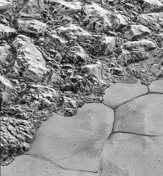 A high-resolution image of the al-Idrisi mountains at Pluto's Sputnik Planum region...taken by NASA's New Horizons spacecraft on July 14, 2015.