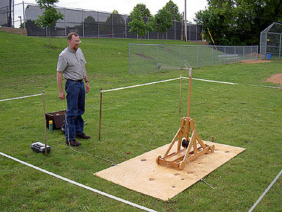 Jim fires the trebouchet