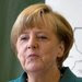 Chancellor Angela Merkel is being pushed to accept policies for Germany that would include its first minimum wage and sharply increased spending on infrastructure, education and energy.
