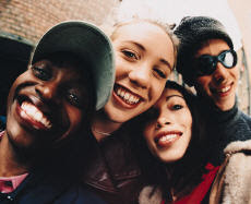 Photograph of a group three female teenagers and one male teenager