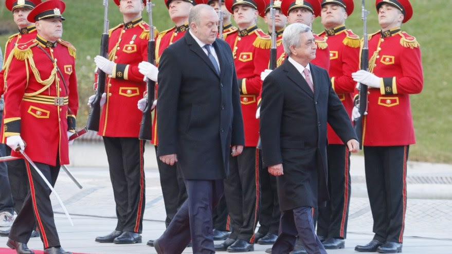File Photo: Georgia's President Giorgi Margvelashvili (L) and President of Armenia Serzh Sargsyan (R) inspect the honor guard during the welcoming ceremony at the President's residence in Tbilisi, Georgia. EPA, ZURAB KURTSIKIDZE
