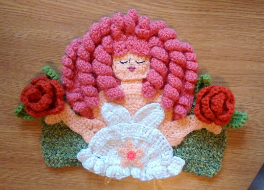 Rose Quartz! Another appliqué design for my growing collection of Steven Universe crochet pieces.  I had lots of fun figuring out how to do her beautiful curly hair - and although you can't see it in the photos, the wool for her dress has silver thread running through it, so she sparkles! I haven't got a proper decoration for her gem yet so there's just a doodle in paint for now. Also - I popped her alongside Ruby and Sapphire to show a size comparison - they're both about 6 inches in height.  For anyone who's interested, I've managed to cobble together a pattern here.