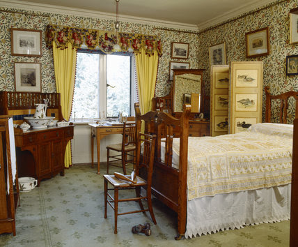 The Yellow Bedroom with William Morris Pomegranate or Fruit wallpaper, at Cragside