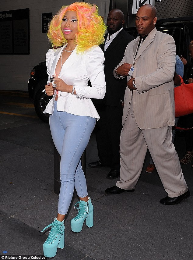 Quite the entourage: Nicki turned up with bodyguards in tow