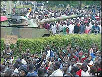 French tank and Ivorian demonstrators at a rally in Abidjan