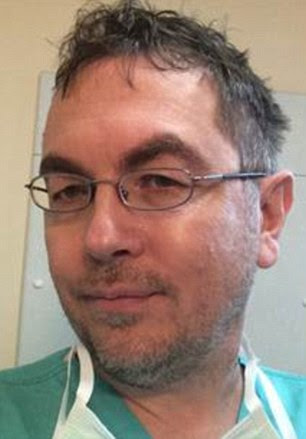 Dr Vladislav Rogozov (pictured) claimed that a Muslim surgeon walked out of an operation because she was asked to remove her religious headscarf
