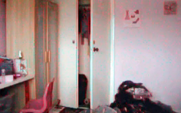 Weird: These grabs from the home video show a pink chair moving from left to right