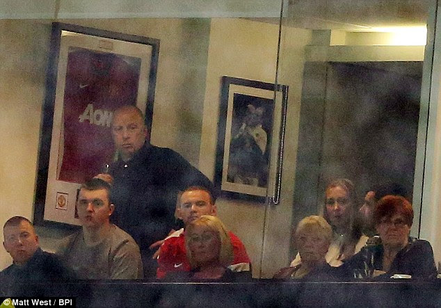 Sidelined: An injured Wayne Rooney watched on from an executive box at Old Trafford as United won 4-3