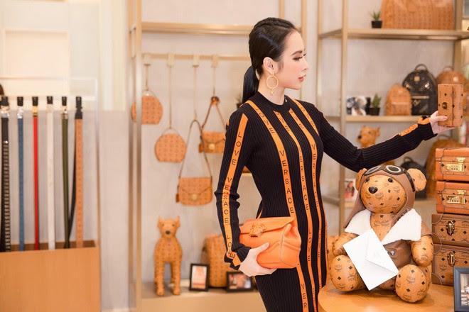 Bầu bí 2 lần nhưng Huyền Baby diện váy ôm khoe đường cong chẳng kém Angela Phương Trinh - Ảnh 1.