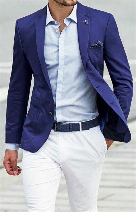 Dark blue / navy blazer . White shirt . White / ice grey