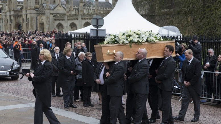 Pallbearers carry the coffin of Stephen Hawking during his funeral at the University Church of St. Mary the Great in Cambridge, Britain, 31 March 2018. World-renowned British phsicist Stephen Hawking died on 14 March 2018 at the age of 76 at his home in Cambridge. EPA, STR UK AND IRELAND OUT