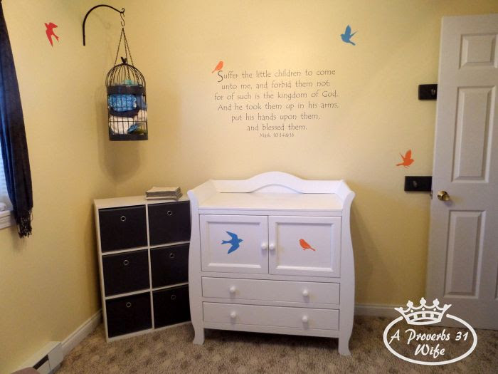 Setting up a baby nursery in grey and yellow, with a birds and branches theme