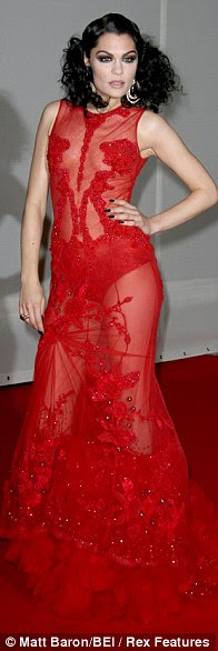 Red alert: Jessie J's outfits on The Voice have been bizarre: patterned pyjamas and even a tutu, which should be barred on anyone over six. But at the Brits she looked fabulous - a splash of colour for a change, and a bit of cheekiness