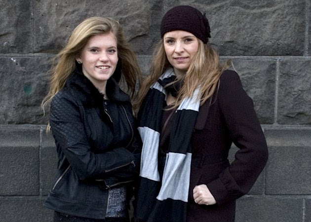 """In this Sunday, Dec. 30, 2012 photo, Blaer Bjarkardottir, 15, left, and her mother, Bjork Eidsdottir, are photographed outside a court building in Reykjavik. Blaer Bjarkardottir is bringing legal action against the Icelandic government to allow her to use her name, which is not on the list of 1,853 government-approved female names. Blaer's mother is supporting her daughter's right to have her name recognized. She said she did not know the name wasn't on the list when she chose it for her daughter. Icelandic law requires names to comply with Icelandic grammar and orthography. The name means """"light breeze"""" in Icelandic. There are 1,712 approved male names. (AP Photo/Anna Andersen)"""