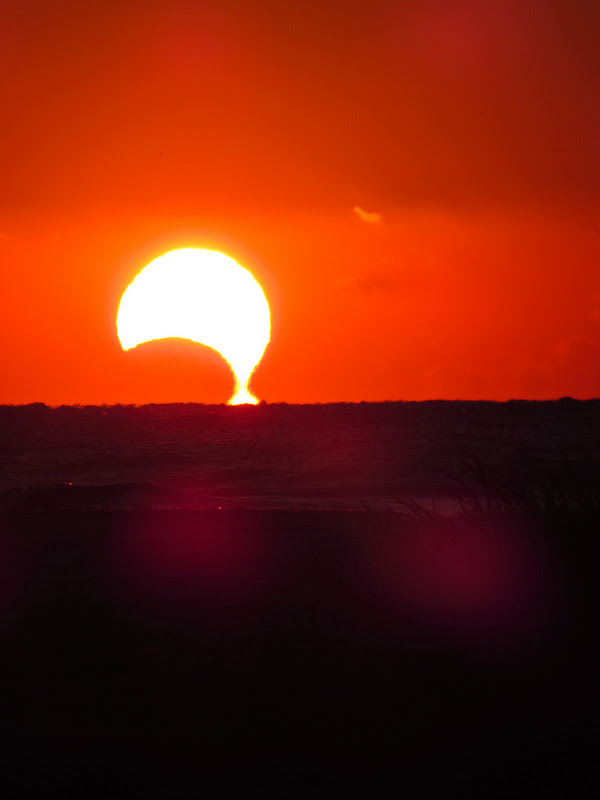The November 3, 2013 partial solar eclipse is seemingly dripping into the ocean, as seen from Sullivan's Island, South Carolina. Credit and copyright: Jeff Jackson