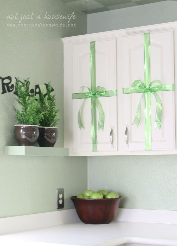 Plants on a shelf. Something interesting for wall beside cabinets.