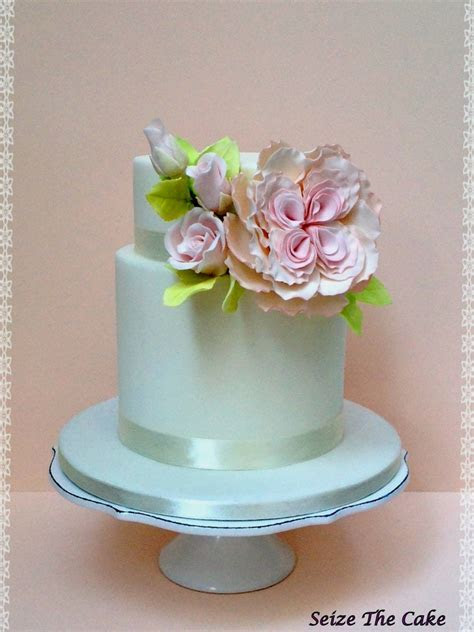 Wedding Cake Decorated With A Full Open David Austin's