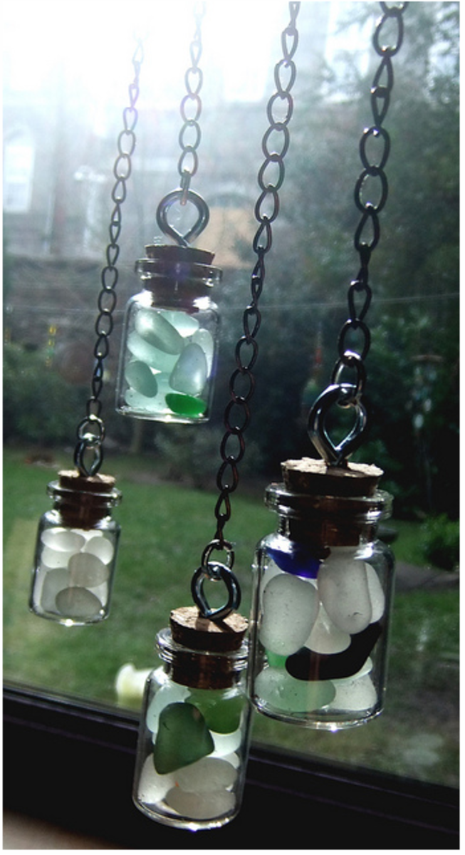 Pretty ornaments made by filling mini corked glass bottles with sea