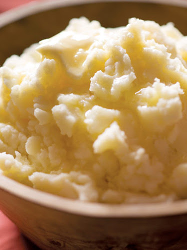 To keep mashed potatoes warm until the meal is served, place them in a heat-proof bowl and cover with foil. Set that bowl in a pot of barely simmering water that reaches halfway up the side of the bowl. Recipe: Tom's Perfect Mashed Potatoes