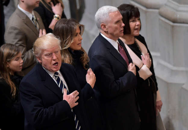 US President Donald Trump, First Lady Melania Trump, Vice President Mike Pence and Karen Pence attend the National Prayer Service at the National Cathedral on January 21, 2017, in Washington, DC.