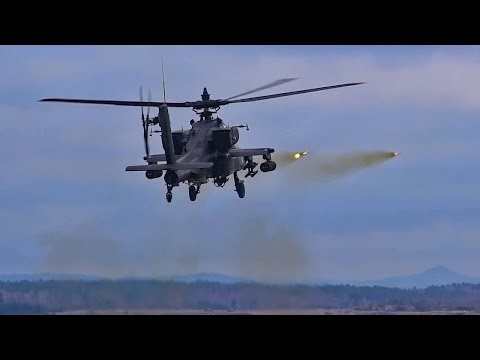 Apache Helicopter Gunships On The Target Range