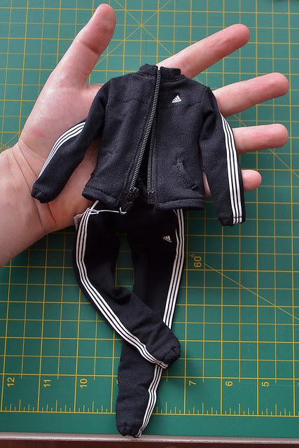1/ 6 scale custom made tracksuit in my husbands hand