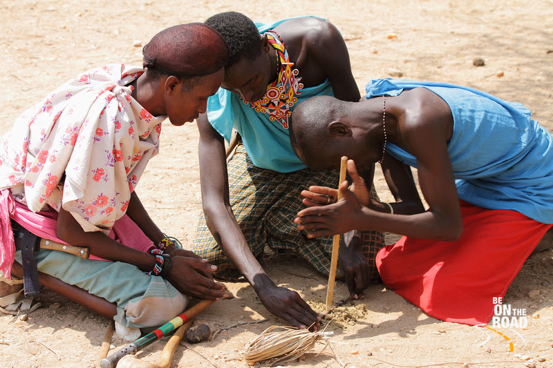 Samburu men make a fire by rubbing two types of stick over dried donkey dung