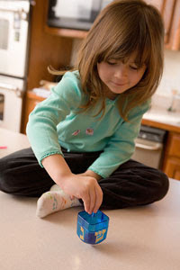 Photo: Girl playing with toy