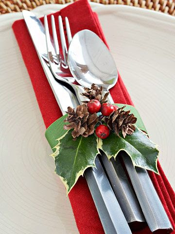 Cranberry and Holly Silverware Wrap ~  A simple loop of green grosgrain ribbon decorated with a berried holly sprig hugs silverware and a Christmas-red napkin.