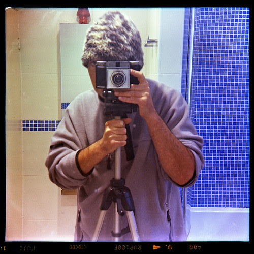 reflected self-portrait with Paxina camera and strange hat by pho-Tony
