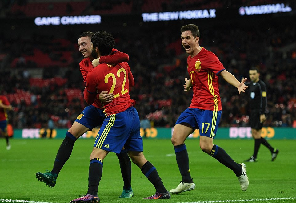 Isco beat replacement goalkeeper Tom Heaton in the sixth minute of injury-time to hand Spain a draw on Tuesday night