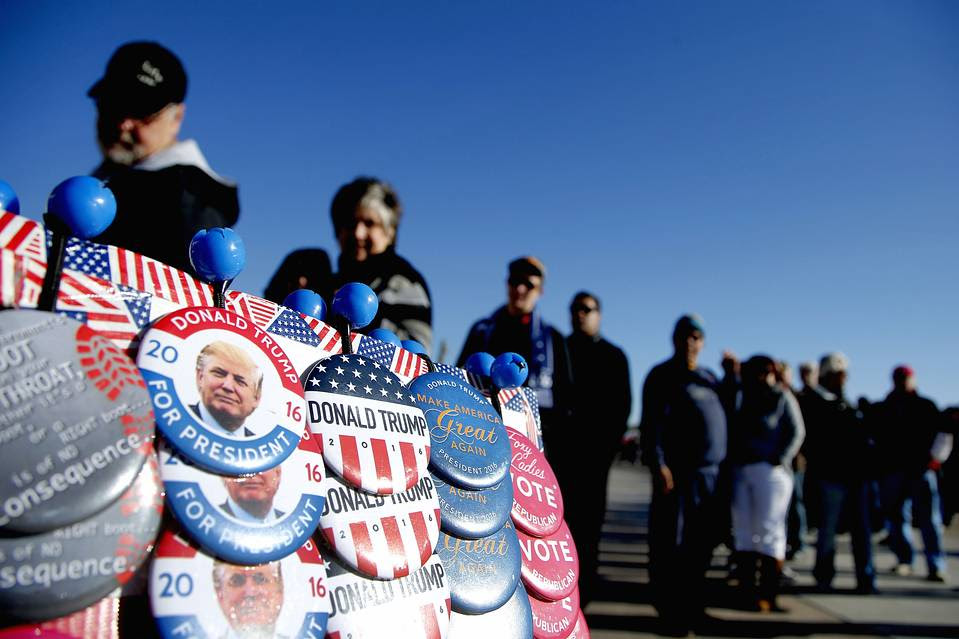 Supporters lined up before a campaign rally for Republican presidential candidate Donald Trump on Dec. 16, 2015, in Mesa, Ariz.