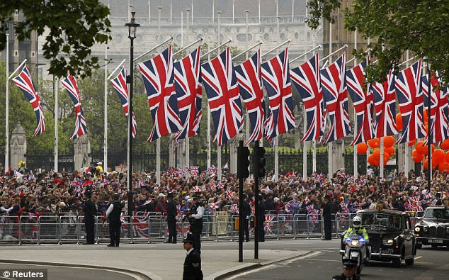 They came in their thousands: Royal fans lining the route cheer as guests arrive before the wedding of Britain's Prince William and Kate Middleton