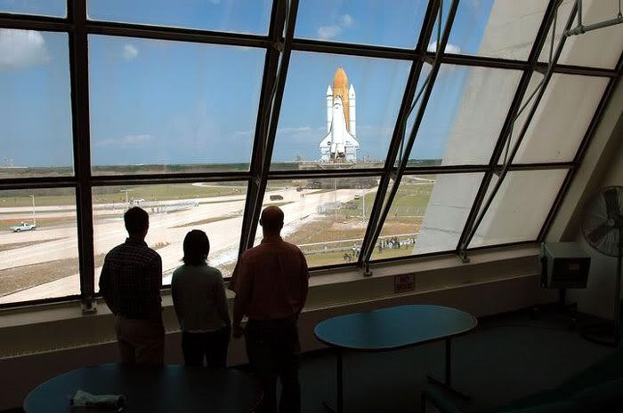 Space Shuttle Discovery rolls out to its launch pad.